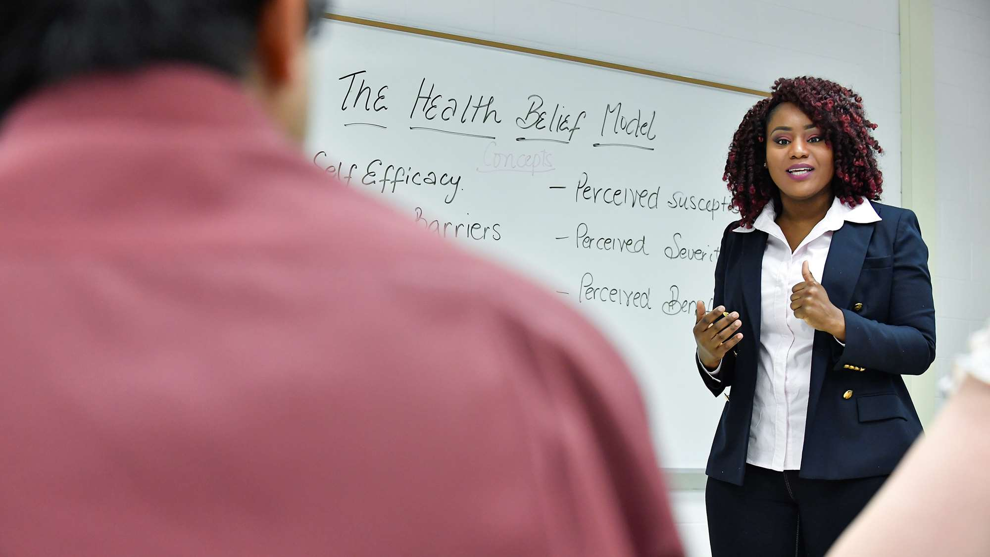 School of Public Health student presenting in a classroom.