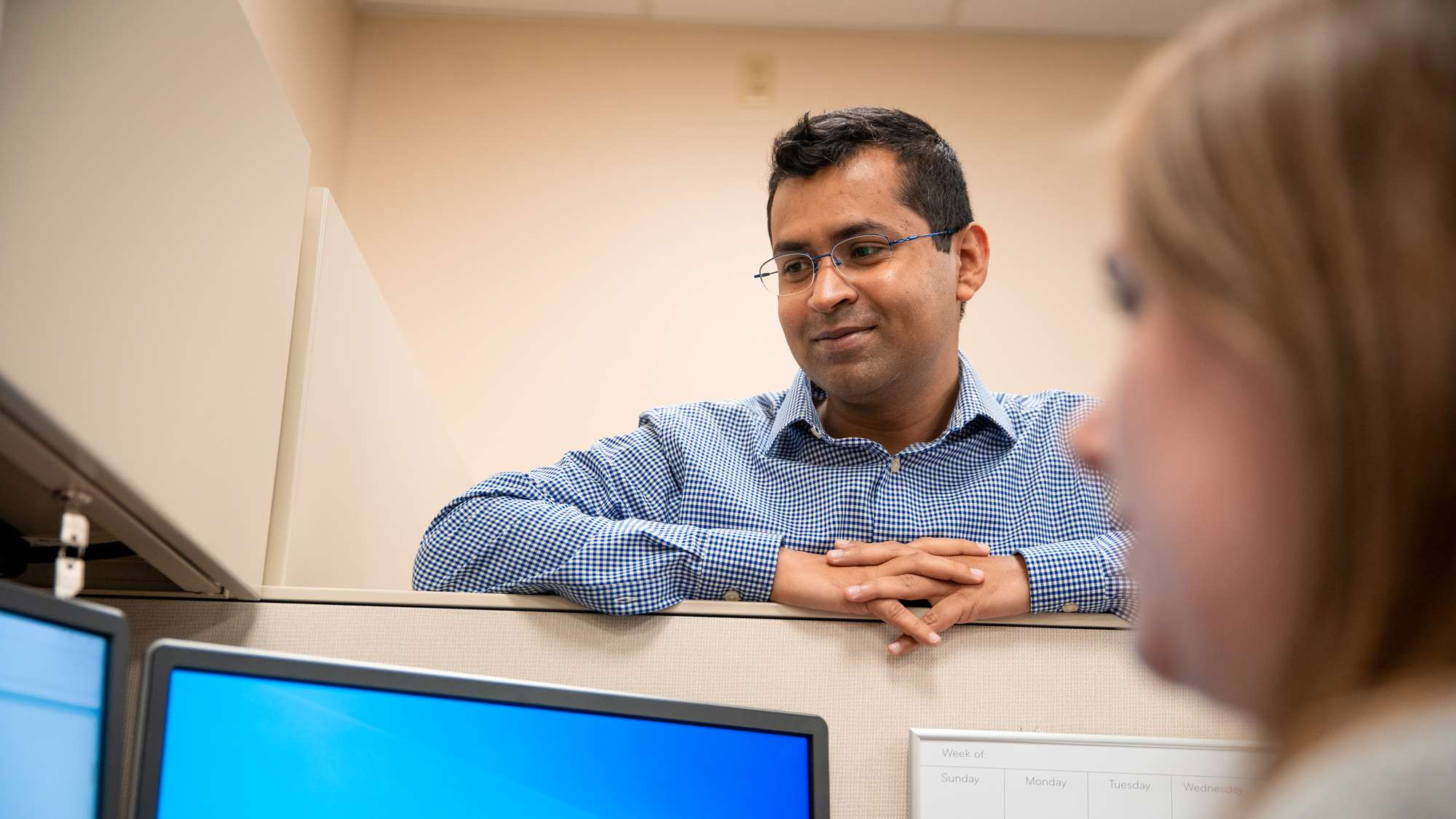 Doctoral student Raihan Khan provides mentorship to a fellow student.